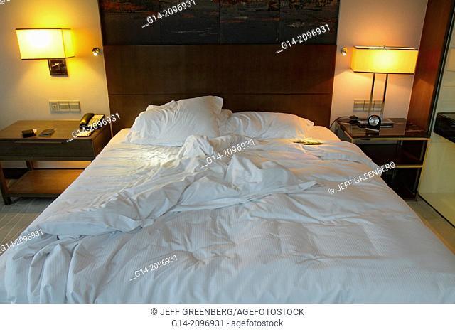 China, Beijing, Guang An Men Nei Da Jie, Guanganmen Outer Street, Beijing Hilton DoubleTree, hotel, guest room, king-size bed, unmade,