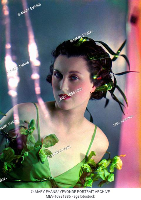 Lady Bridget Poulett (1912 - 1975), only daughter of Earl Poulett and society beauty, dressed as Arethusa for the Goddesses series of colour Vivex photographs...