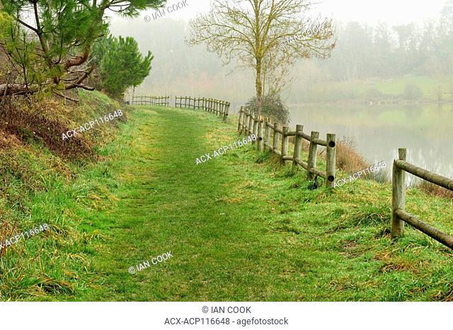 grass roadway beside Lac de l'Escoourou, near Eymet, Dordogne Department, Aquitaine, France