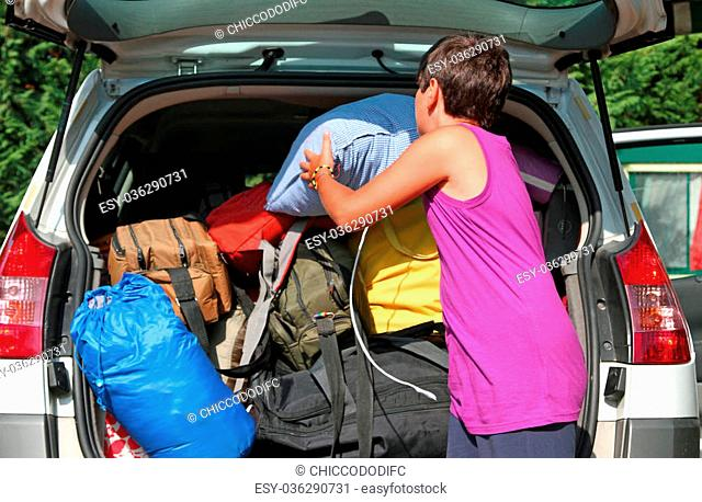 young boy with purple shirt car baggage charge before departure