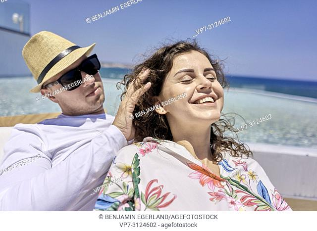 lovers, man caressing hair of woman, holiday, summer, couple, pool