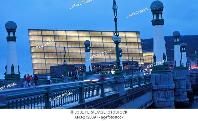 On background Kursaal Palace by the architect Rafael Moneo, Zurriola Bridge with streetlights Art Deco over river Urumea, Donostia, San Sebastian, Gipuzkoa