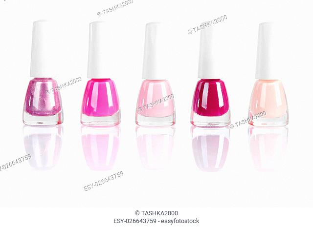 bright nail polishes isolated on white. Clipping path included