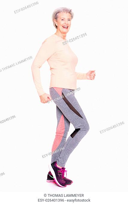 studio shot of an active senior in sports against white background