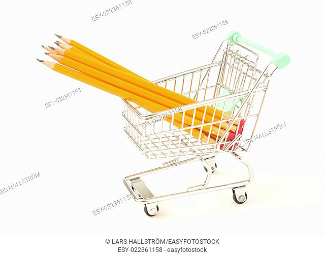 Shopping cart with yellow pencils on white background. Conceptual image of writing, school and education