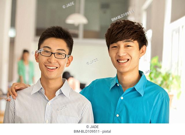 Chinese businessmen smiling together