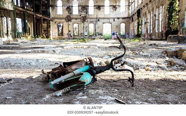 Rusted bicycle abandoned inside an old factory