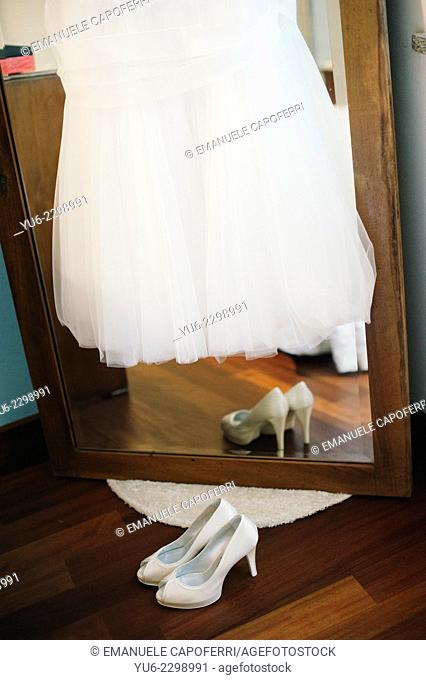Shoes and wedding dress and mirror