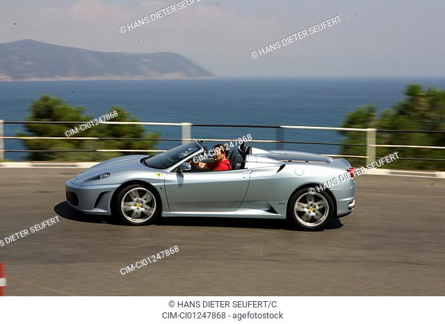 Car, Ferrari F430 Spider F1, model year 2005-, silver, Convertible, driving, side view, country road, landsapprox.e, open top