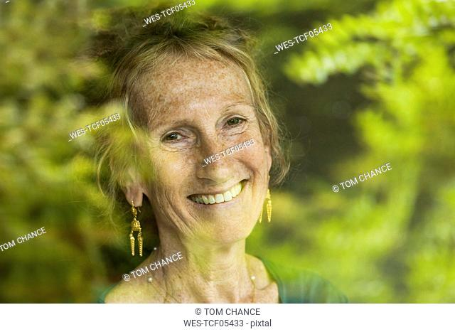 Portrait of happy senior woman with freckles