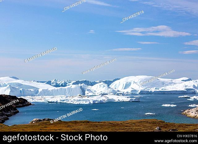 Majestic glacial icebergs on sunny remote Atlantic Ocean Greenland