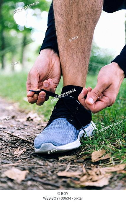 Jogger tying his shoes