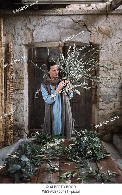 Woman arranging twigs