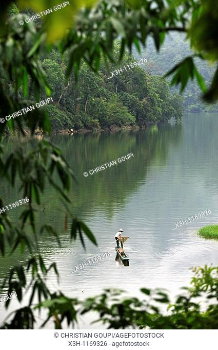 fisherwoman with a dugout canoe on Ba Be Lake,Bac Kan province,Northern Vietnam,southeast asia