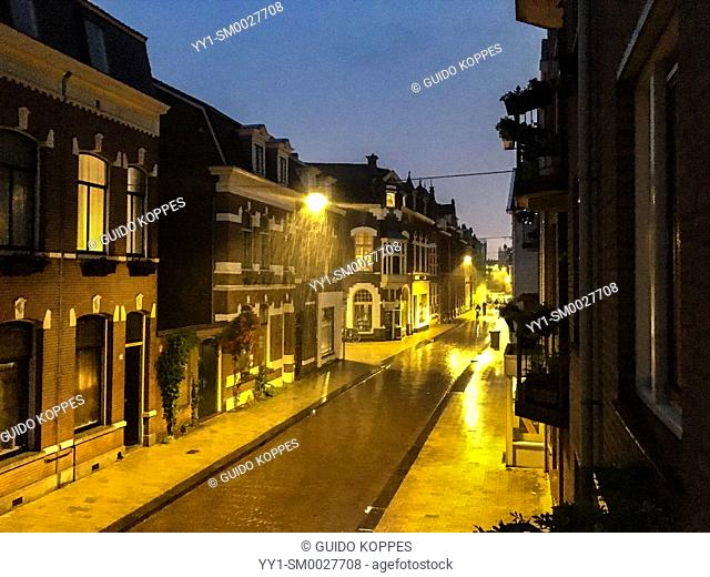 Tilburg, Netherlands. Residential, down town street by Night and Rain with Thinder