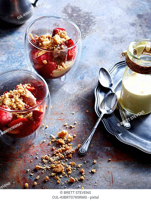 Bowls of strawberry crisp with cream