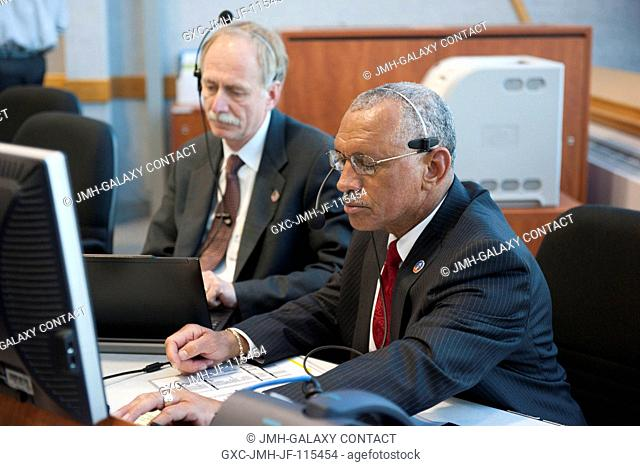 In Firing Room 4 of the Launch Control Center at NASA's Kennedy Space Center in Florida, NASA Administrator Charlie Bolden (foreground) and Associate...