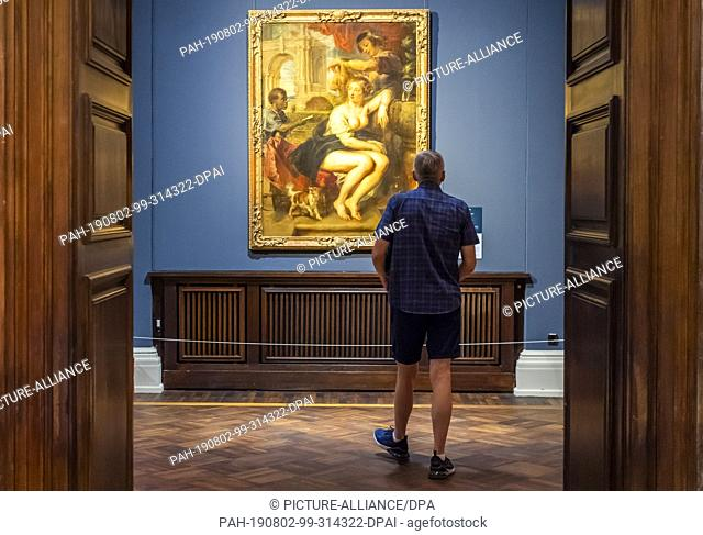 """02 August 2019, Saxony, Dresden: A visitor looks at the work """"""""Bathsheba at the fountain"""""""" by Peter Paul Rubens in the exhibition """"""""Highlights of the Old..."""