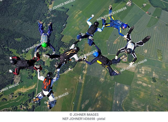 Skydivers in formation mid-air