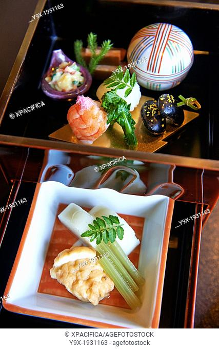 Traditional Japanese ryokan food served in small dishes