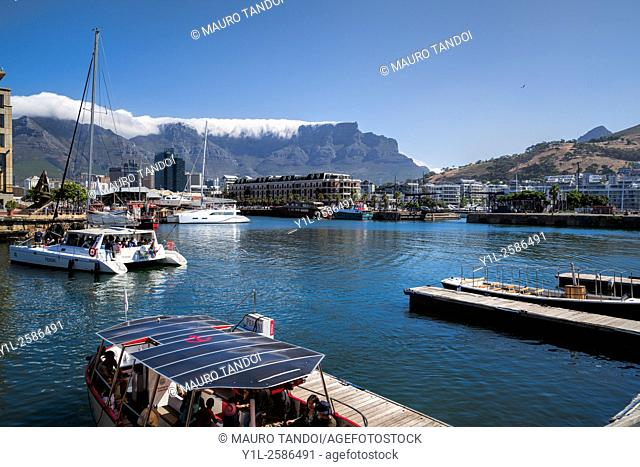 Panoramic view with Victoria and Alfred Waterfront, harbor with recreation boats, downtown and Table Mountain on background in Cape Town, South Africa