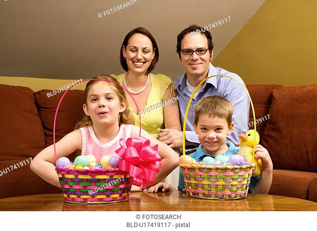 Caucasian family with Easter baskets looking at viewer