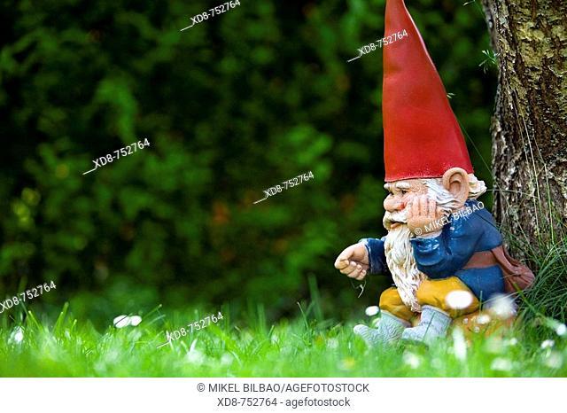 Ceramic dwarf in the garden