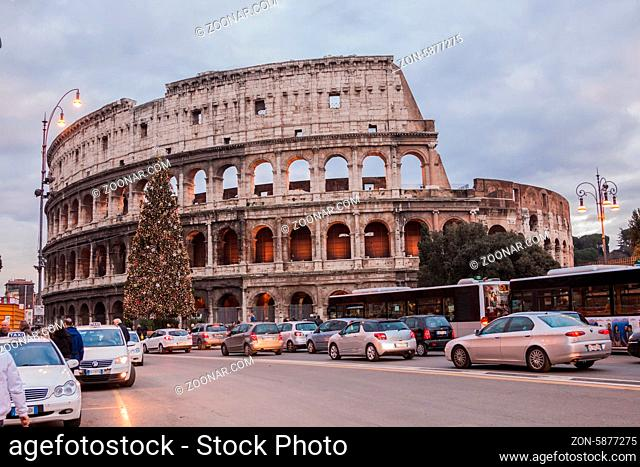 ROME -OCTOBER 21: Coliseum exterior on October 21, 2012 in Rome, Italy. The Coliseum is one of Rome's most popular tourist attractions with over 5 million...
