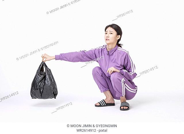 NEET woman throwing away trash