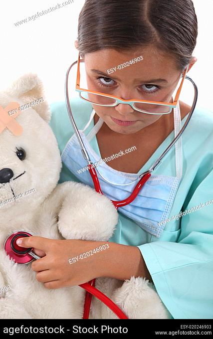 Little girl dressed in nurses outfit