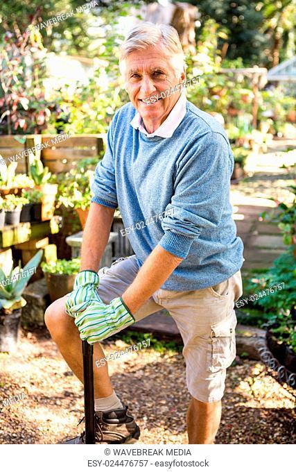 Portrait of confident gardener at garden