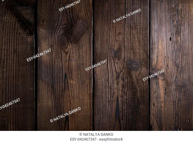 brown wooden background from old boards with cracks and knots