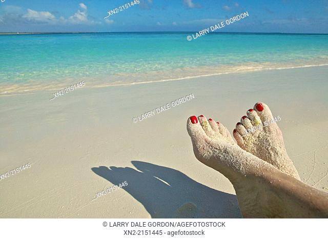 Tourist relaxing on a Caribbean beach in Tobago Cays, St. Vincent and the Grenadines