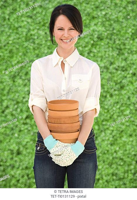 Woman holding terra cotta pots
