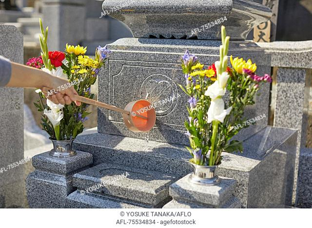 Japanese woman at a cemetery