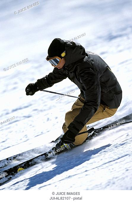 Person skiing down mountain