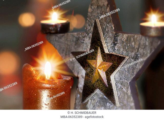 Burning candles with decoration star