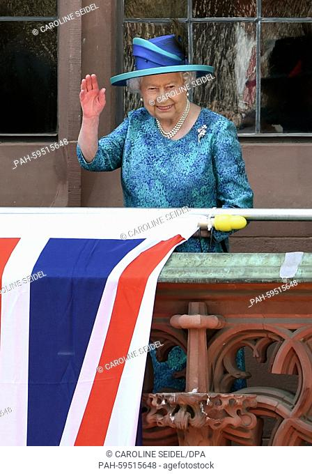 Britain's Queen Elizabeth II waves as she stands on the balcony of the Roemer in Frankfurt/Main,Germany, 25 June 2015. The Queen and her husband are on their...