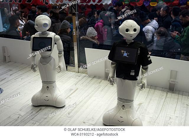 Tokyo, Japan, Asia - Two semi-humanoid robots of the Pepper series are seen in a shop window in the city ward of Shibuya