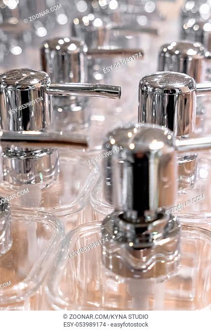 Close-up of empty dispensers for soap, gel and more