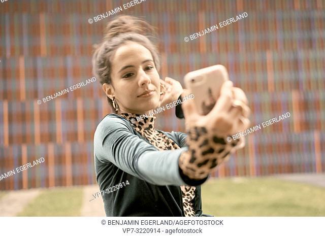 confident woman using smartphone, taking selfie, video conversation