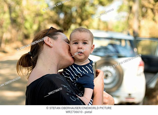 Costa Rica, Guanacaste, mother kisses her baby, mother with baby traveling with car hire in Costa Rica