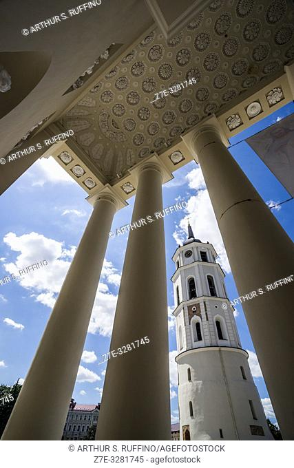 Vilnius Belfry (Bell Tower) framed through the portico columns of the Cathedral Basilica of St. Stanislaus and St. Ladislaus