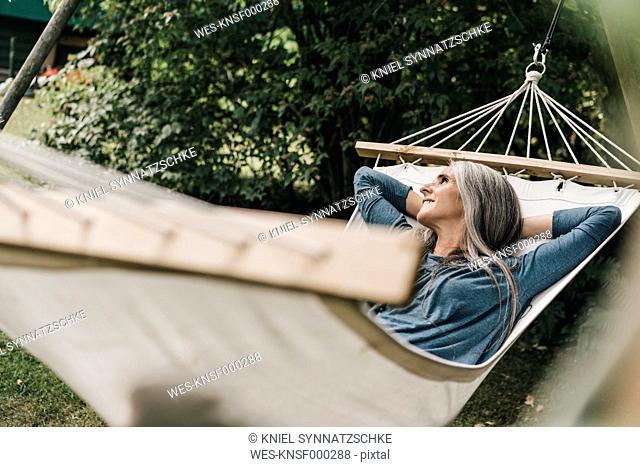 Woman relaxing in hammock in the garden