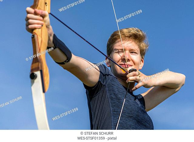 Portrait of archeress aiming with her bow