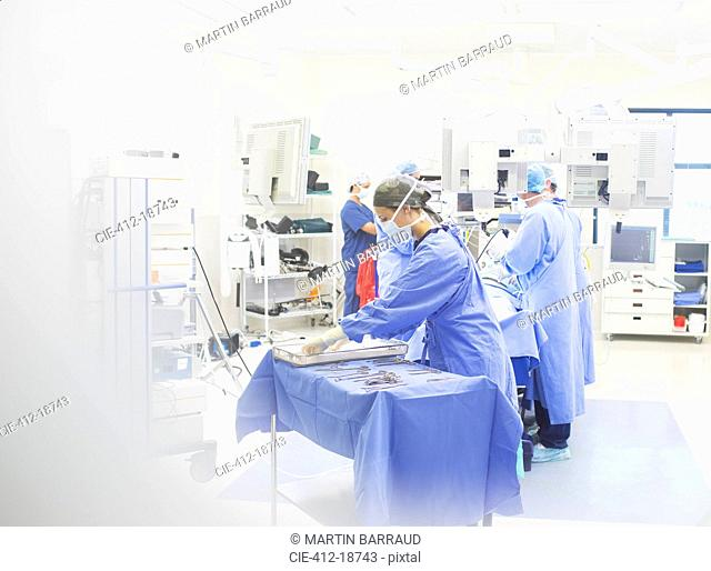 Team of surgeons performing surgery in operating theater