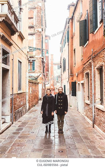Portrait of couple in street, Venice, Italy