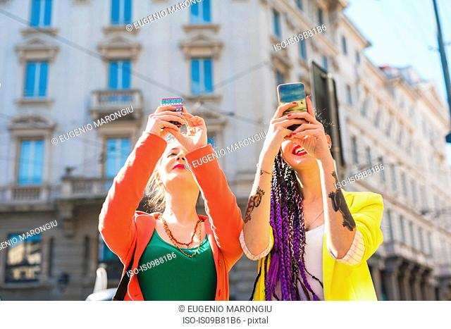 Women taking selfie, Milan, Italy