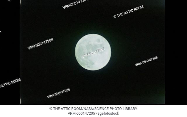 View of the full Moon from the Apollo 17 Command Module. Darker lunar mare can be seen on its surface. Date recorded: 1972-12-07 to 1972-12-19