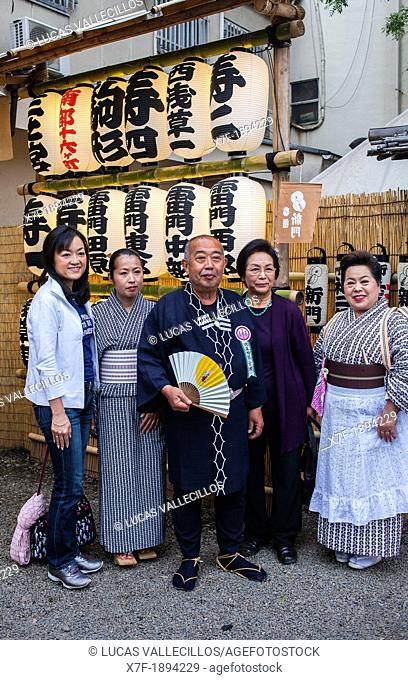 Family dressed in traditional costume, during Sanja Matsuri, in Senso-ji temple, Asakusa,Tokyo city, Japan, Asia